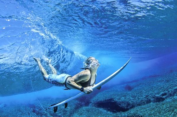 surfer girl underwater duckdive